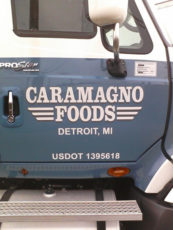 Semis Caramagno Foods Name Location Usdot On The Front Doors Of A Blue Semi Tractor Trailer